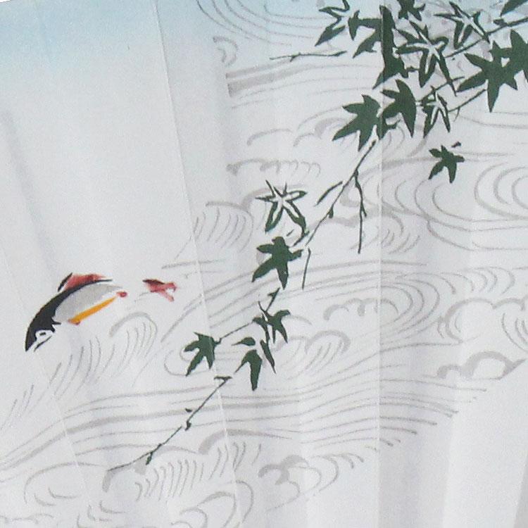 上絵職人が一本一本絵付けを施した扇面。